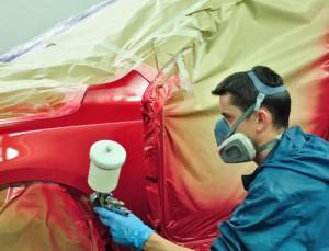 Процесс покраски краскопультом